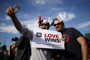 Kai Kuna, 44, (L) and Richard Schatz, 47, take a selfie at a celebration rally in West Hollywood, California, United States, June 26, 2015. The U.S. Supreme Court ruled on Friday that the U.S. Constitution provides same-sex couples the right to marry in a historic triumph for the American gay rights movement. REUTERS/Lucy Nicholson