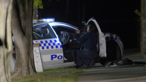 The scene where a police officer was shot earlier this morning in Moonee Ponds, Melbourne, Tuesday, July 7, 2015. A man armed with a shotgun shot the officer in the head as he tried to pull over a car. (AAP Image/Tracey Nearmy) NO ARCHIVING