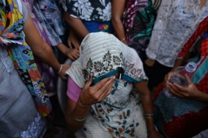 "The Indian grandmother of a minor girl who was raped sits among protesters near the home of the child in New Delhi on October 17, 2015. A toddler and a five-year-old girl were raped in separate attacks in New Delhi overnight with at least one gang-raped, police said October 17, as activists warned of an ""epidemic"" of sexual violence in the capital. The two-and-a-half-year-old girl was abducted from a religious event in west Delhi by two men on the night of October 16 and raped before being dumped in a park near her home, relatives and police said. In a separate incident on the other side of the city, the five-year-old was lured to a neighbour's house and raped by three men, a police officer told AFP. AFP PHOTO / Chandan KHANNA"