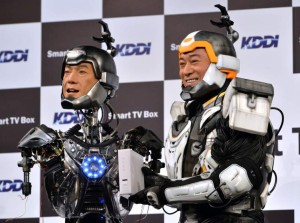 """Japanese actor Ken Matsudaira (R), clad in a robot suit, smiles with an android robot (L) in his likeness called """"Real Android Matsuken"""" at a press presentation in Tokyo on November 19, 2013. The android robot was developed for an advertisement for Japanese telecom company KDDI. AFP PHOTO / YOSHIKAZU TSUNO ' (Photo credit should read YOSHIKAZU TSUNO/AFP/Getty Images)"""