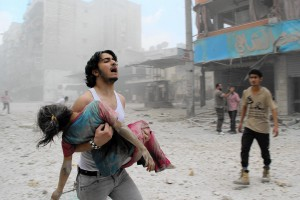 -- AFP PICTURES OF THE YEAR 2014 -- A man carries a young girl who was injured in a reported barrel-bomb attack by government forces on June 3, 2014 in Kallaseh district in the northern city of Aleppo. Some 2,000 civilians, including more than 500 children, have been killed in regime air strikes on rebel-held areas of Aleppo since January, many of them in barrel bomb attacks. AFP PHOTO / BARAA AL-HALABIBARAA AL-HALABI/AFP/Getty Images ** OUTS - ELSENT, FPG - OUTS * NM, PH, VA if sourced by CT, LA or MoD **