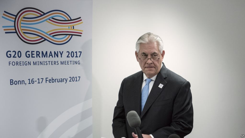 "US Secretary of State Rex Tillerson arrives to make a statement about a meeting with Russia's Foreign Minister at the World Conference Center February 16, 2017 in Bonn, western Germany. US Secretary of State Rex Tillerson makes his diplomatic debut at a G20 gathering in Germany on February 16, 2017 where his counterparts hope to find out what ""America First"" means for the rest of the world. / AFP PHOTO / Brendan Smialowski"